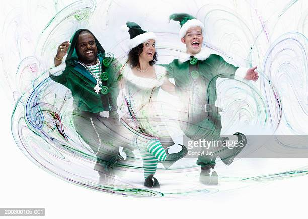 Three christmas elves dancing in line, laughing and cheering, portrait