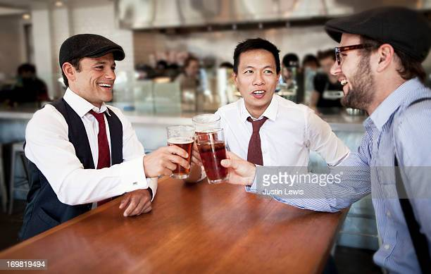Three city guys toasting at lunch