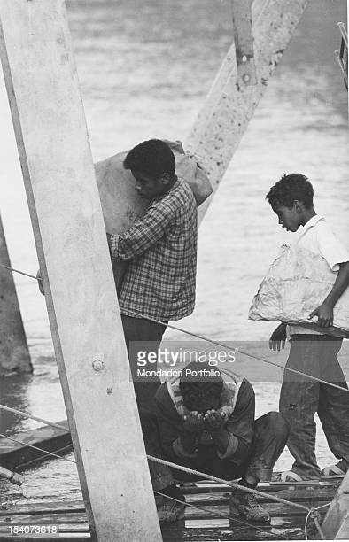 Three civilian refugees crossing the bridge Allenby/King Hussein at the Jordan The bridge was destroyed by the Israelis at the beginning of the...