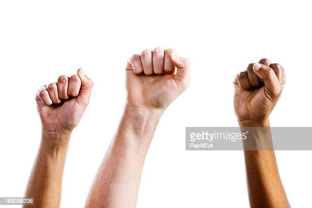 three clenched fists air punch in triumph or defiance - human arm stock pictures, royalty-free photos & images