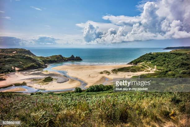 three cliffs bay, gower, swansea, wales. - gower peninsula stock photos and pictures
