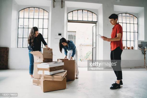 three colleagues are moving into their new office - founder stock pictures, royalty-free photos & images