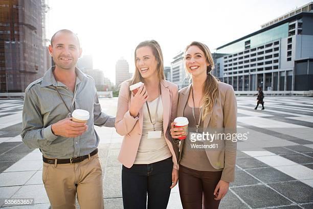 Three colleagues having fun at break time