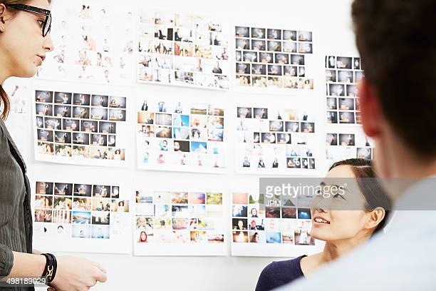 Three colleagues in creative studio