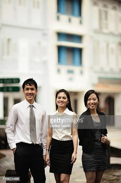 Three colleagues standing outdoors