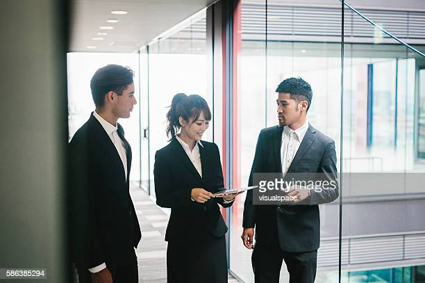 Three Collegues Meet in the Office
