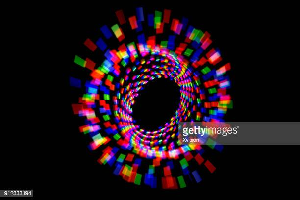 three color spiral image light painting - spiral stock pictures, royalty-free photos & images