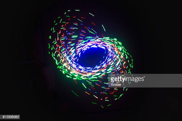 three color spiral image light painting - spectrum stock photos and pictures