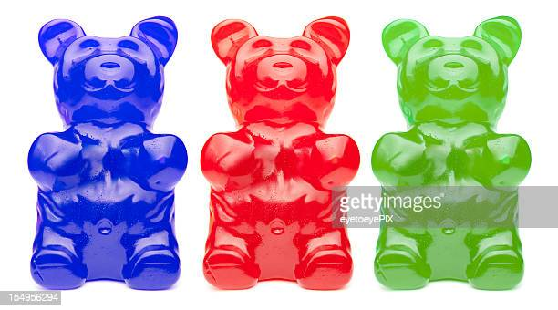 three colorful gummy bears - gummi bears stock photos and pictures