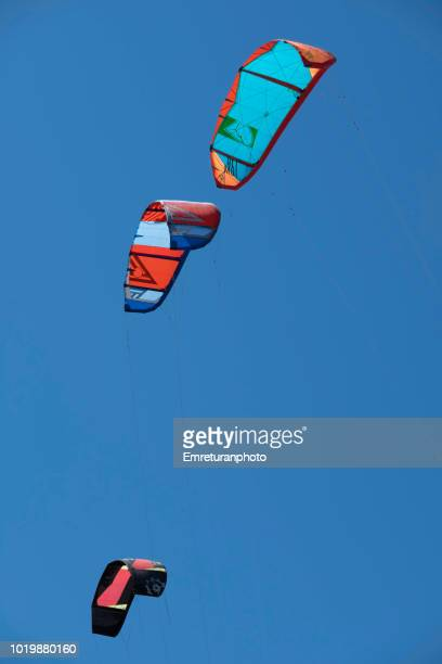 three colorful kites in the sky. - emreturanphoto stock pictures, royalty-free photos & images