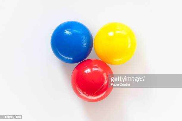 three colorful plastic balls in primary colors - spielball stock-fotos und bilder