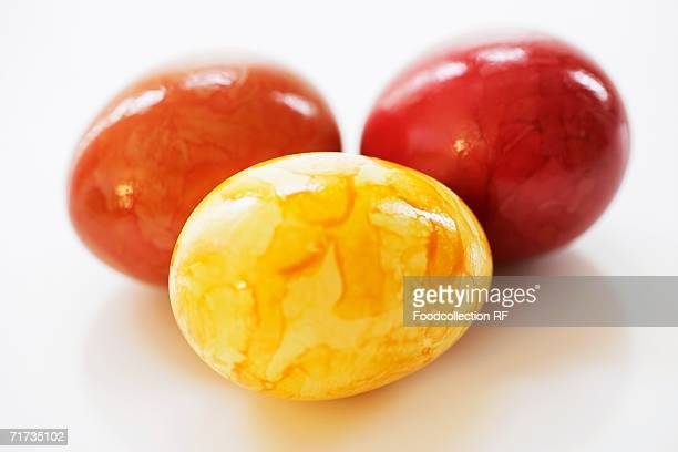 Three coloured eggs