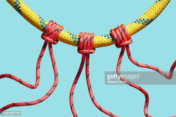 Three coloured ropes supported by a larger rope