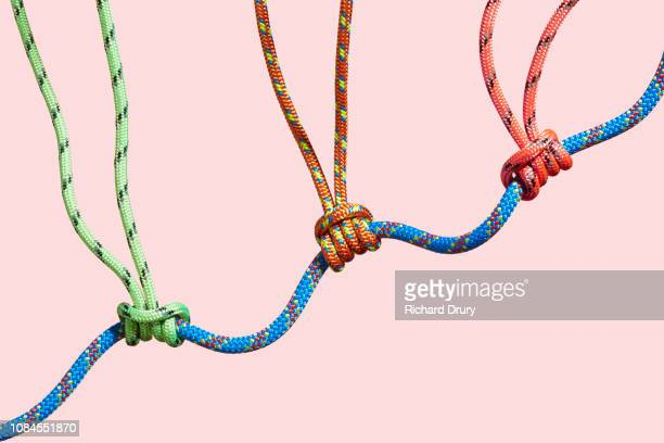 Three coloured ropes supporting a larger rope