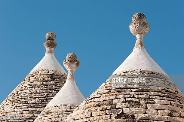 Three Conical Roofs of Trullo Houses Alberobello Trulli District Puglia Italy