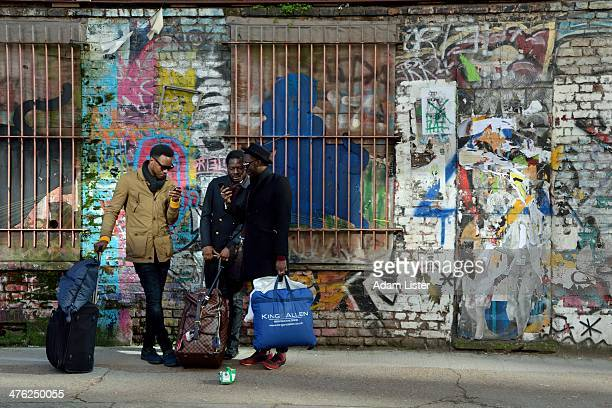 CONTENT] Three cool stylish fashionable young men are seen off Brick Lane East London They are standing in an urban graffiti / street art covered...