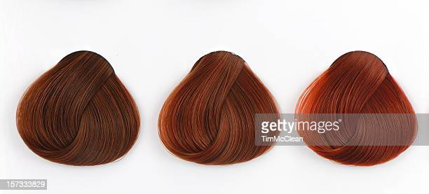 three copper hair swatches