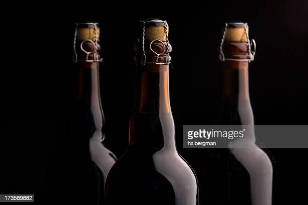 Three corked beer bottles