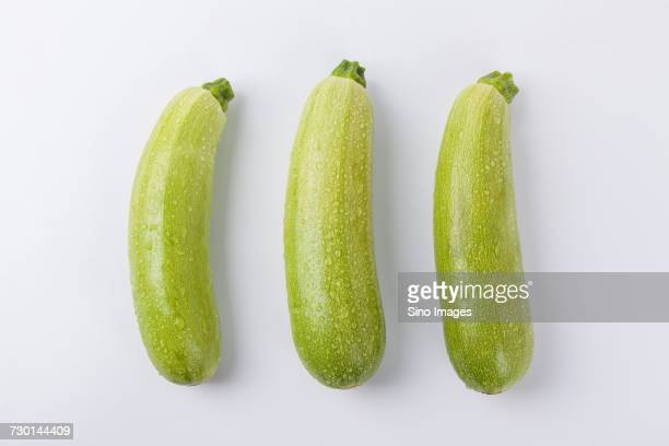 Three courgettis on white background, China