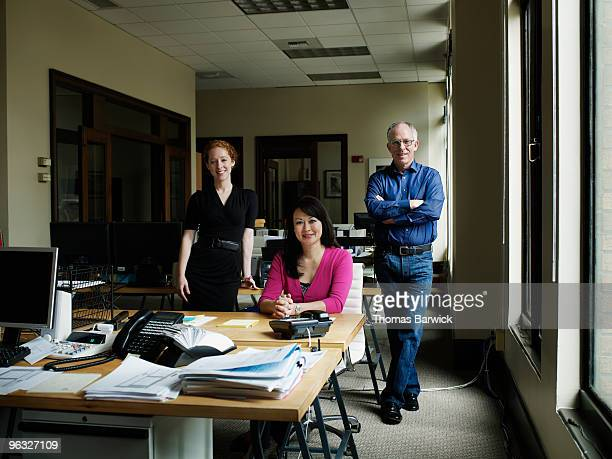 three coworkers in office - leanintogether stock pictures, royalty-free photos & images