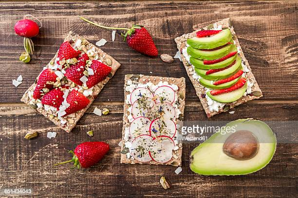 Three crispbreads with different toppings