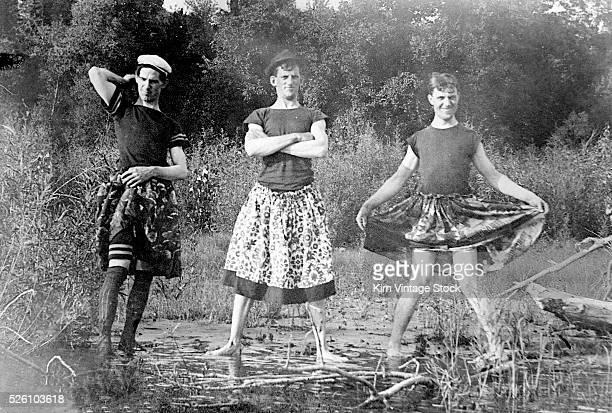 Three crossdressing men show off their finest skirts ca 1905