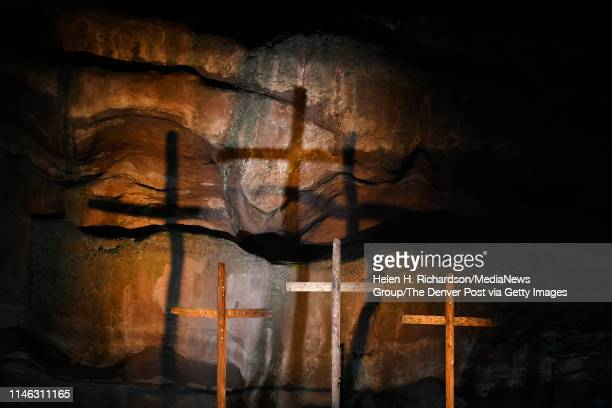 Three crosses are lit on the back of the stage for Easter sunrise service at Red Rocks Amphiteatre on April 21 2019 in Morrison Colorado This is the...
