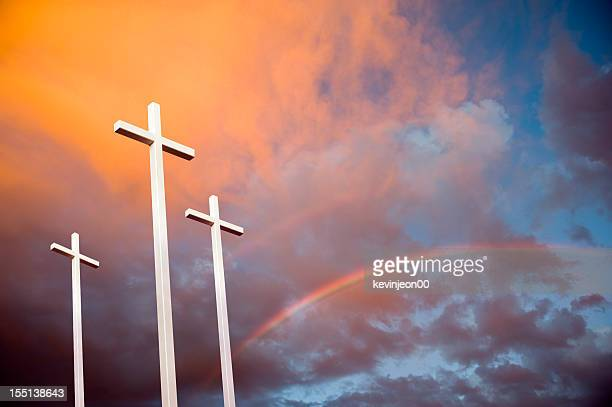 three crosses at sunset - death and resurrection of jesus stock photos and pictures