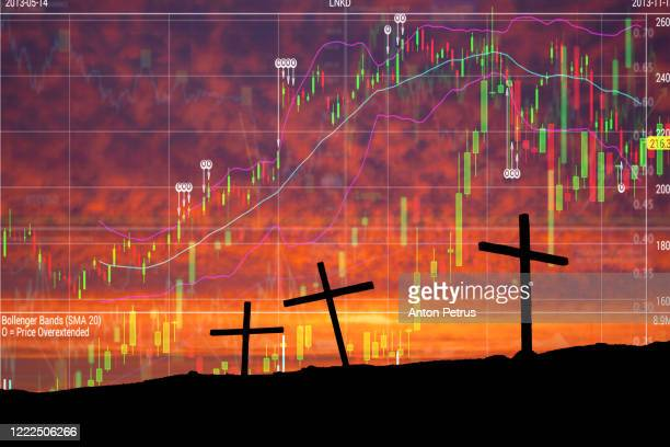 three crosses on the background of stock charts. world financial crisis - mort concepts photos et images de collection