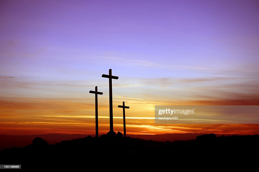 Three crosses standing at the sunset : Stock Photo
