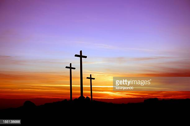 three crosses standing at the sunset - death and resurrection of jesus stock photos and pictures