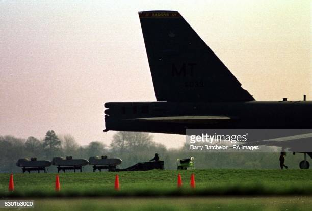Three cruise missiles being loaded onto a B52 bomber at RAF Fairford Two B52 bombers flew from RAF Fairford in Gloucestershire under the cover of...