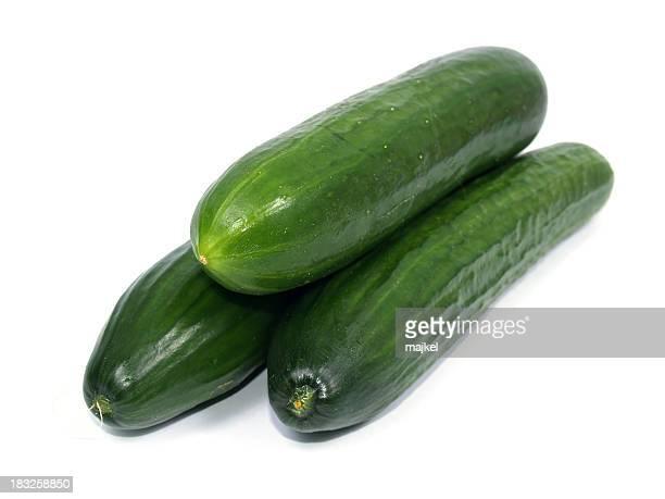 Three cucumbers on white background