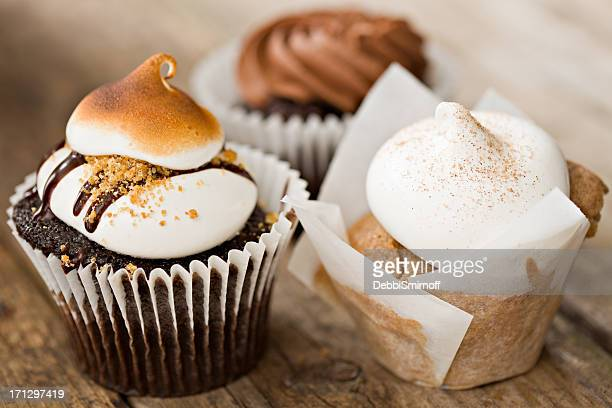 three cupcakes - snickerdoodle stock pictures, royalty-free photos & images