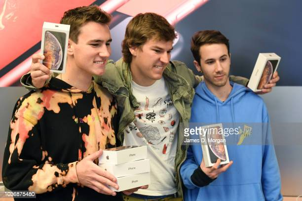 Three customers celebrate their new purchase at the Australian release of the latest iPhone models at the Apple Store on September 21 2018 in Sydney...