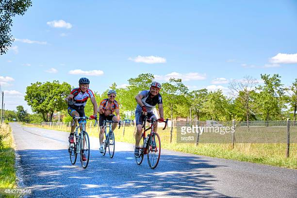 Three cyclists on French country road