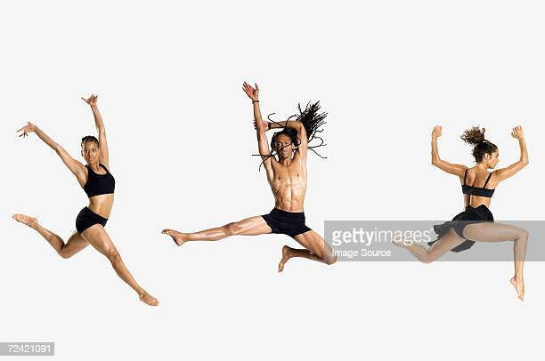 three dancers jumping - modern dancing stock pictures, royalty-free photos & images