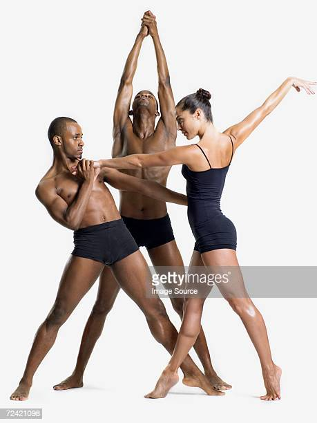 three dancers performing - modern dancing stock pictures, royalty-free photos & images