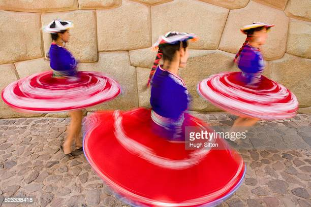 three dancers twirling at hatun rumiyoc - hugh sitton stock pictures, royalty-free photos & images