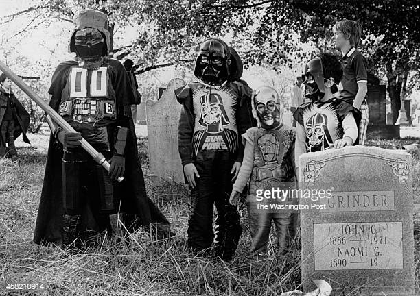 Three Darth Vaders and one CP30 all inspired by the movie 'Star Wars' appeared at the Hallows Eve fun raiser for Congressional Cemetery in 1977