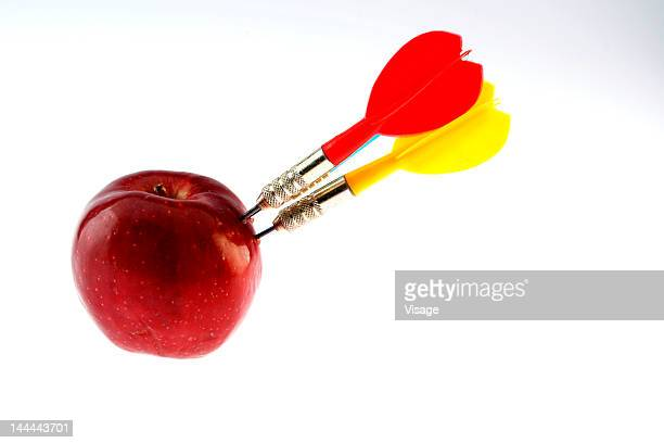 Three darts and an apple
