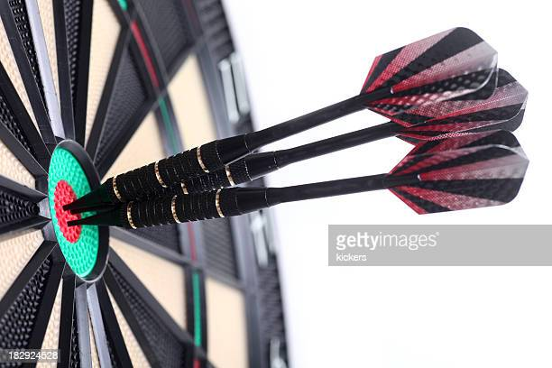 Three darts in bull's eye, isolated