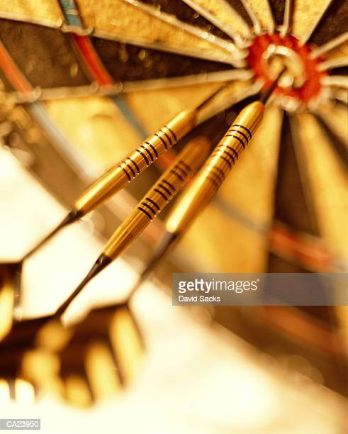 three darts in dartboard, close-up - darts stock pictures, royalty-free photos & images