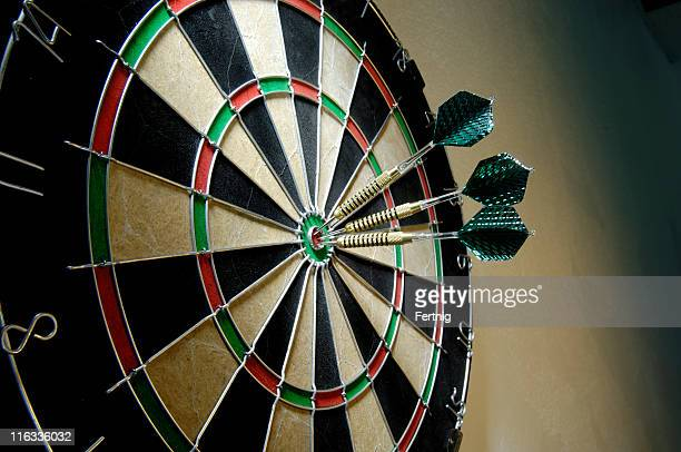 Three darts on a bullseye