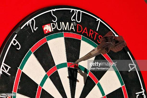 Three darts sit in the triple twenty to score 180 points in the Superleague Darts at Shed 6 on September 6 2014 in Wellington New Zealand