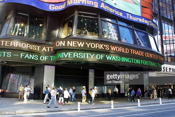 Three days after the World Trade Center terrorist attack, people walk past the Good Morning America set in Times Square September 13, 2001 in New...