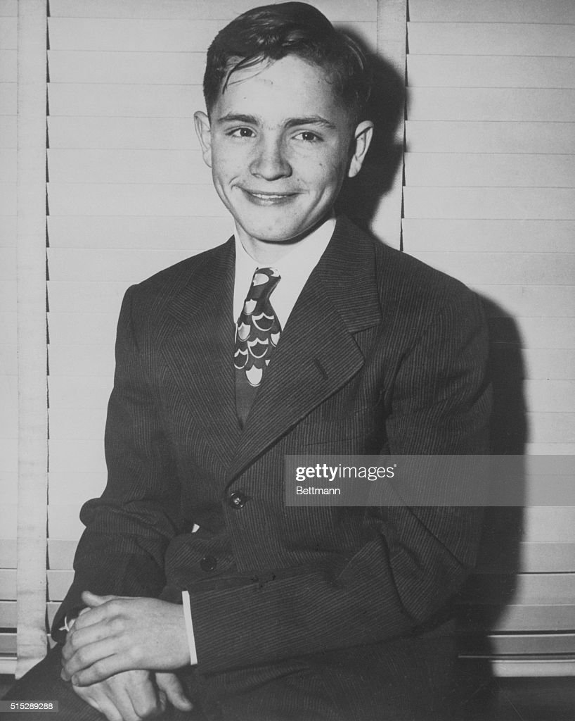 Three days before he ran away from Boy's Town, Charles Manson poses in a suit and tie.