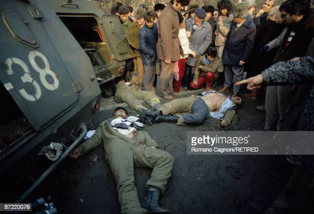 Three dead members of Ceausescu's security team lie in the town centre of Bucharest during the Romanian Revolution December 1989