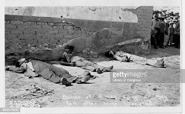 Three dead men left lying by a wall after being executed during the Mexican Revolution Ca 19111914