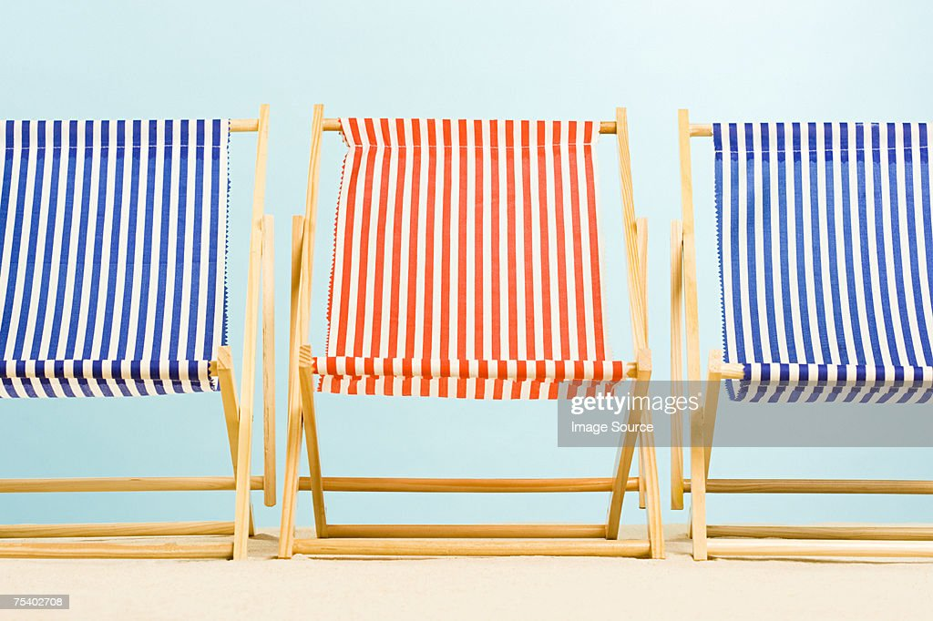 Three deckchairs : Stock Photo